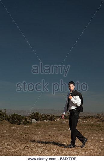 Businessman in wilderness - Stock Image