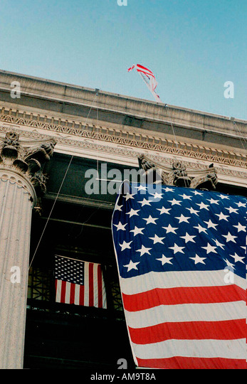 Three American Flags on the James Farley Branch of The United States Post Office in New York City USA - Stock Image