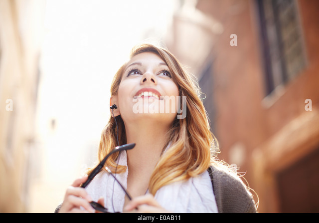 Young woman looking up at buildings, Rome, Italy - Stock-Bilder