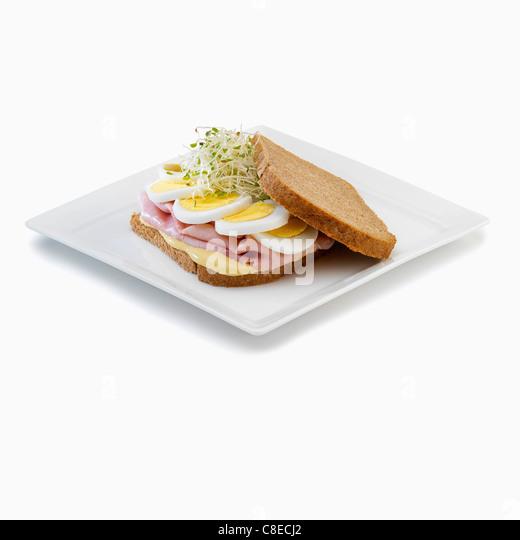 Ham and hard-boiled egg sandwich - Stock Image