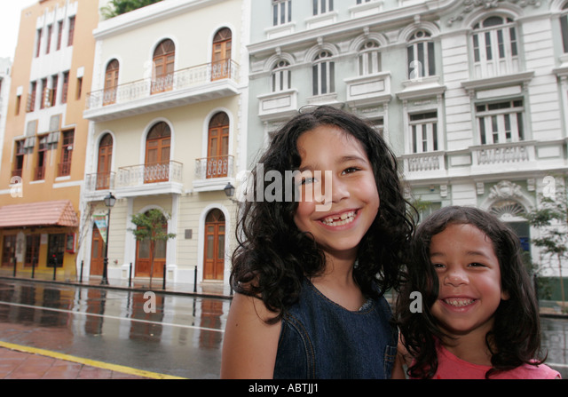 Puerto Rico Old San Juan Calle Recinto Sur Hispanic sisters smile architecture - Stock Image