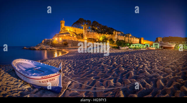 Blue hour at the beach in Tossa de Mar, Girona, Catalonia, Spain - Stock Image