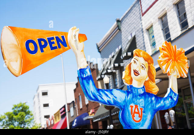 Auburn Alabama North College Street college town athletics Tigers female cheerleader cutout marketing business district - Stock Image