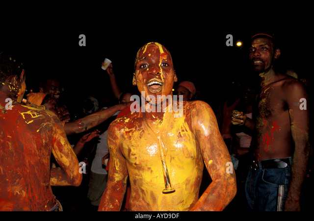 Trinidad Carnival Jouvert Morning Man covered in painted mud - Stock Image
