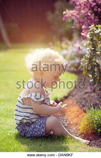 little girl in garden - Stock Image