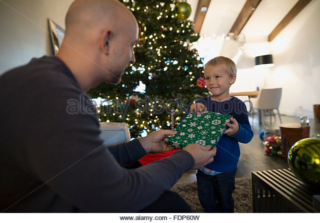 Father giving son Christmas gift - Stock Image