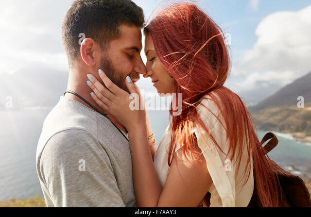 Portrait of affectionate young couple about to kiss. Romantic young man and woman sharing a lovely moment on their - Stock-Bilder