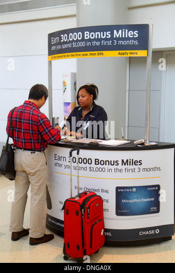 New Jersey Newark Newark Liberty International Airport EWR terminal concourse gate area booth credit card promotion - Stock Image