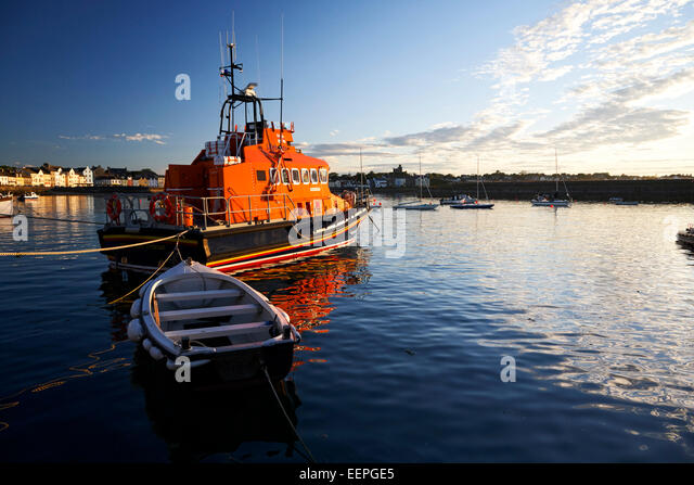 rnli lifeboat in donaghadee harbour at sunset - Stock Image