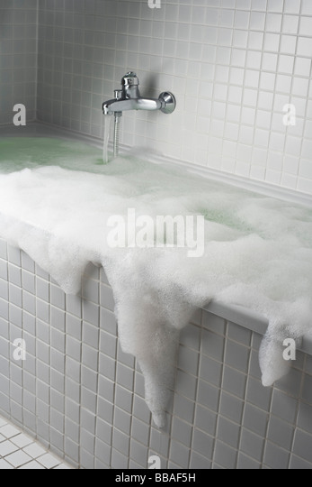 An overflowing bubble bath - Stock Image