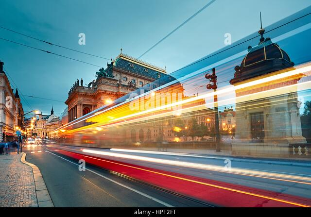 The historic building of the National Theatre in Prague and traffic on the busy street in downtown. - Stock Image