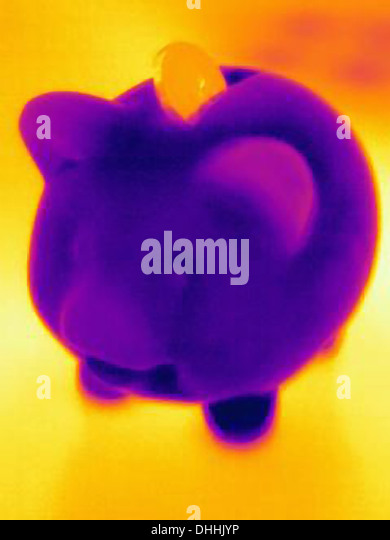 Thermal photograph of piggy bank with coin - Stock Image