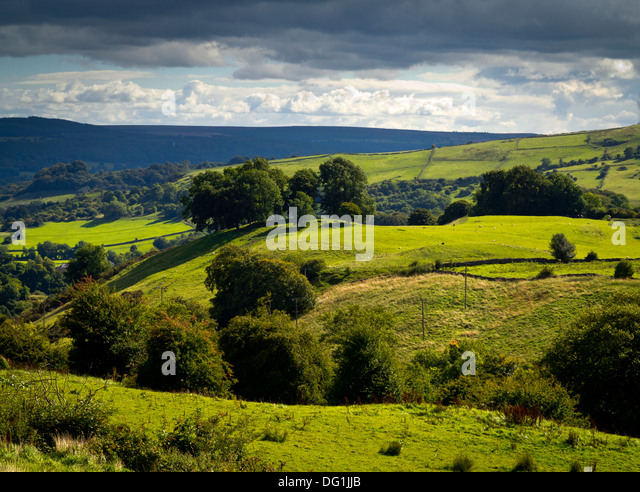 View across countryside near Eyam village in the Peak District National Park Derbyshire England UK with stormy sky - Stock Image