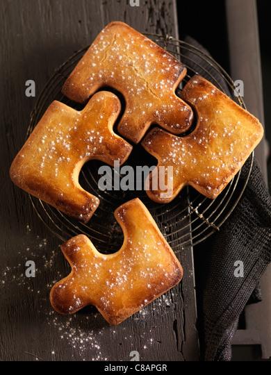 Puzzle-shaped Christmas cakes - Stock Image