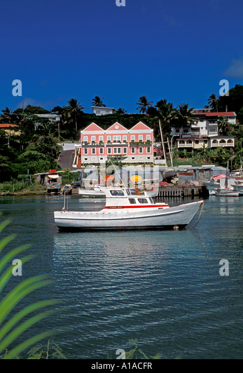 St Lucia  Castries skyline fishing boat palm tree - Stock Image