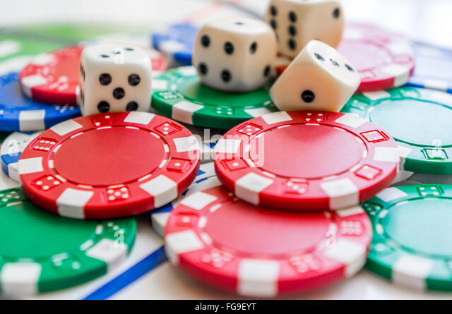 Close-Up Of Dice With Gambling Chips - Stock Image