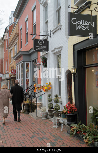 Virginia Alexandria Old Town Alexandria King Street historic district sidewalk store shop boutique business man - Stock Image