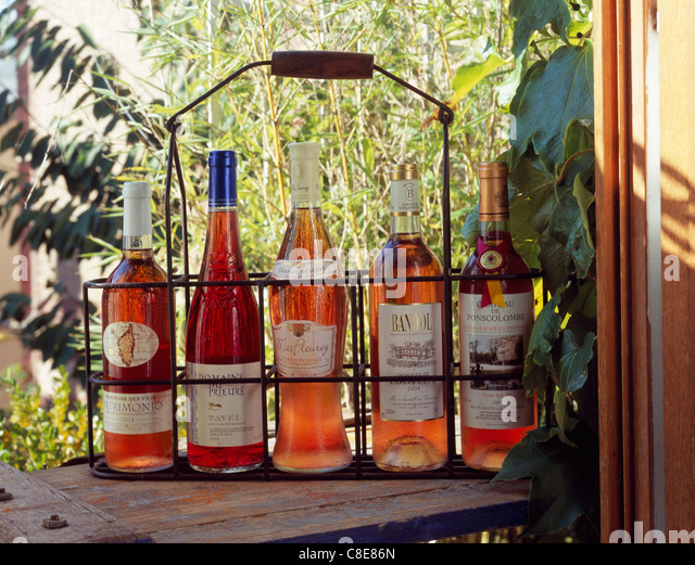 Botles of rosé wine in a bottle carrier - Stock Image