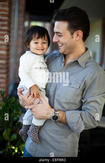 Italy, Lombardy, Milan, Father and daughter (18-23 months) - Stock Image
