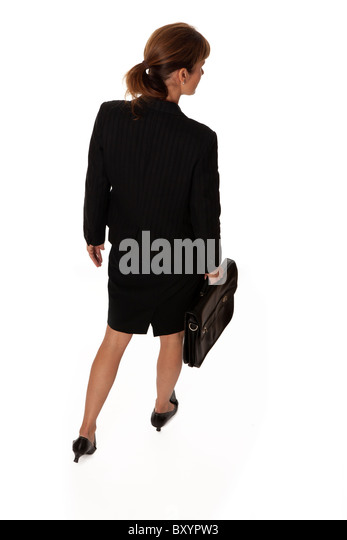 Business woman with briefcase walking away - Stock Image
