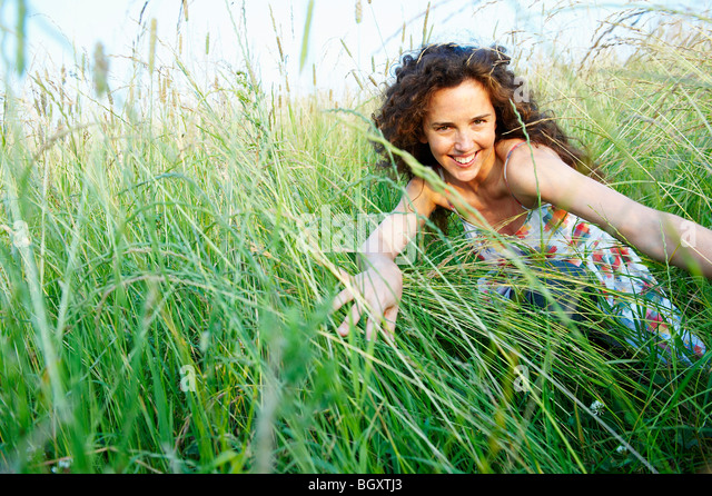 Woman in a wheat field - Stock Image