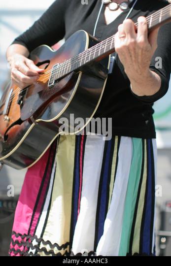 Florida, Zydeco Festival, Cajun music, colorful dress, guitar, - Stock Image