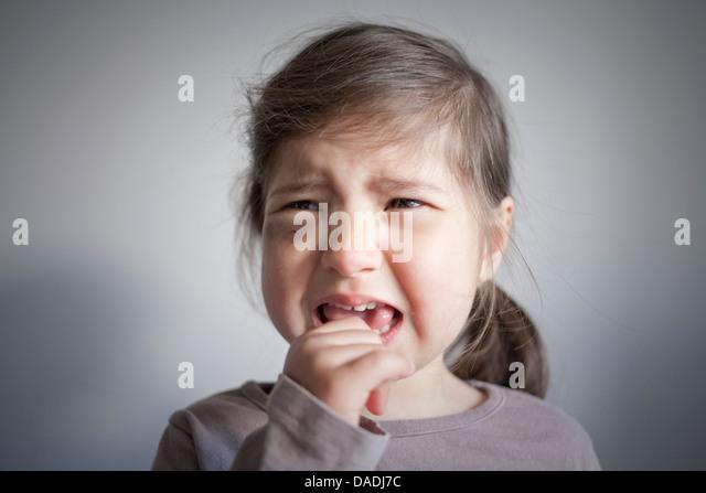 Girl with black eye crying - Stock Image