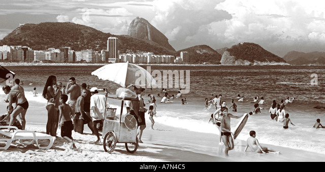 Brazil Rio de Janeiro Copacabana beach Cariocas background Pao de Acucar sugarloaf  - Stock Image