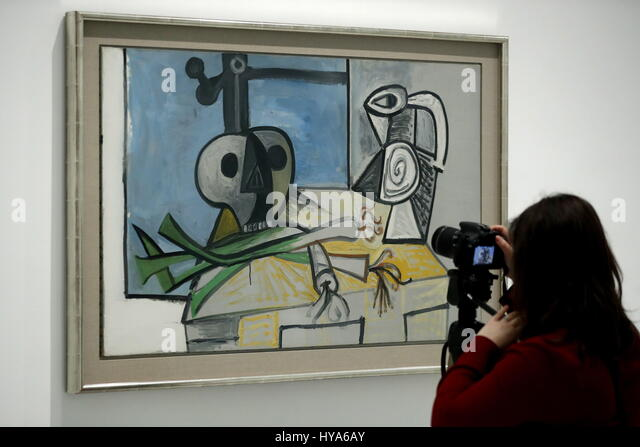 A visitor observes the work of art 'Skull, Leeks and Pitcher', by Spanish artist, Pablo Picasso, during - Stock Image