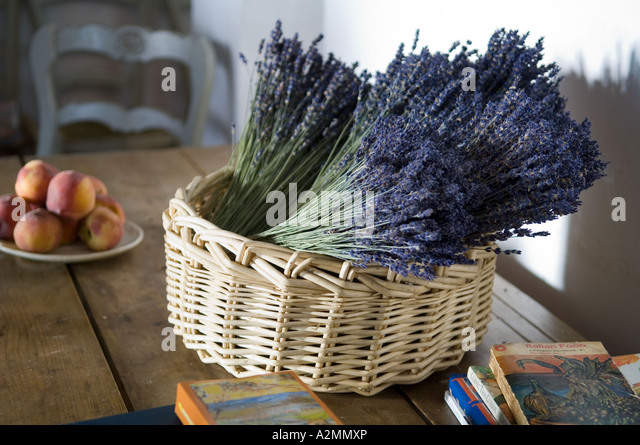 A basket of dried lavender in a country house in Provence - Stock Image
