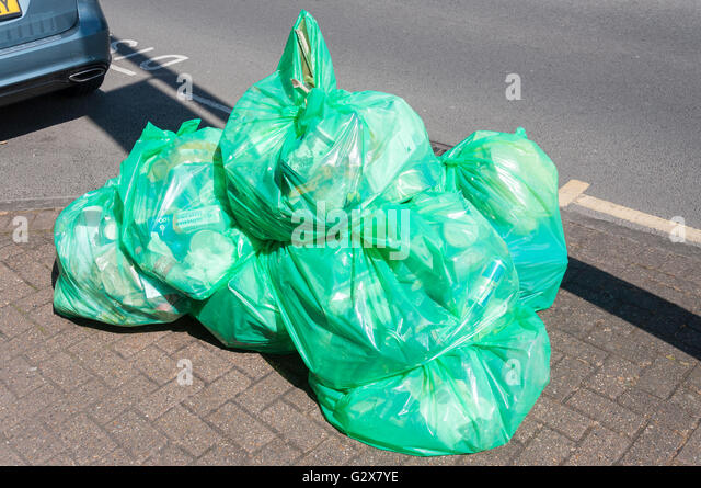 Plastic recycling bags on pavement, Church Road, Ashford, Surrey, England, United  Kingdom - Stock Image