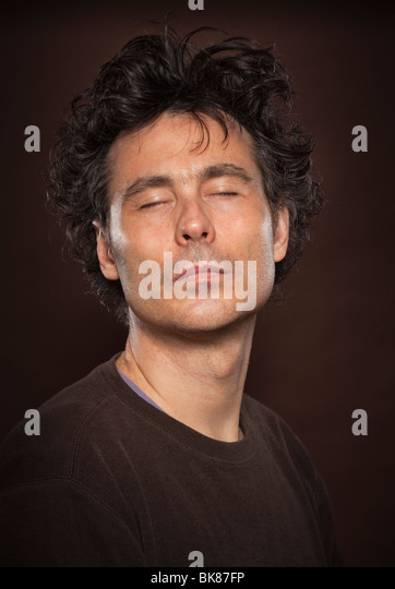 Headshots eyes closed, peaceful - Stock Image