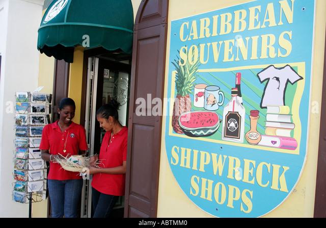 Sint Maarten Philipsburg Dutch duty free shopping souvenirs Black female straw hat - Stock Image