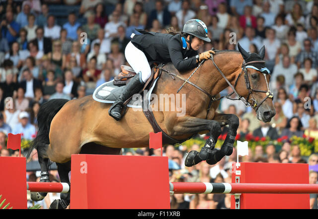 Aachen, Germany. 23rd Aug, 2015. Danielle Goldstein of Israel jumps with her horse Carisma over an obstacle in the - Stock Image