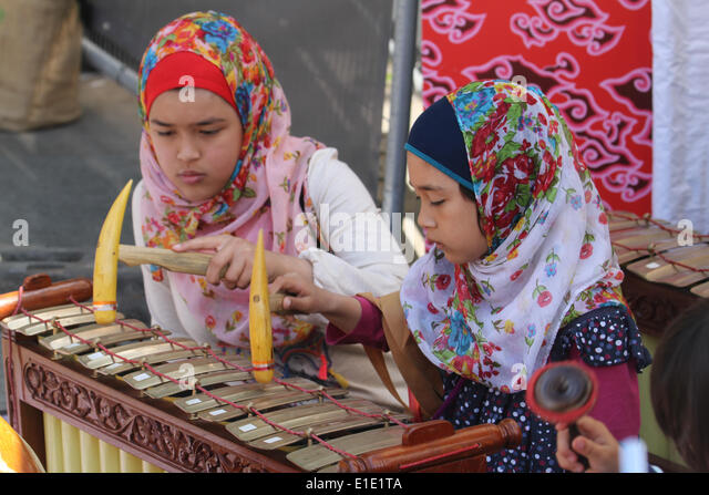 London, UK. 31 May 2014. Two Indonesian girls attend the Gamelan Music Workshop conducted by Aris Daryono. Credit: - Stock Image
