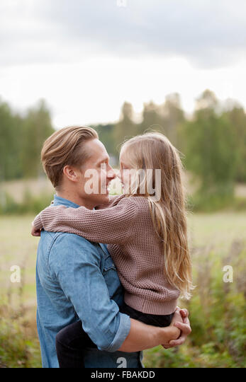 Finland, Uusimaa, Raasepori, Karjaa, Father and daughter (6-7) rubbing noses - Stock Image