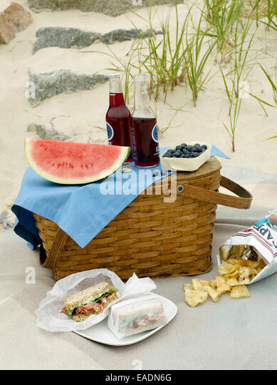 Picnic and picnic basket on the beach - Stock Image