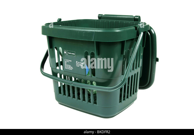 A Green food waste recycling dustbin for use in the kitchen against a white background - Stock Image