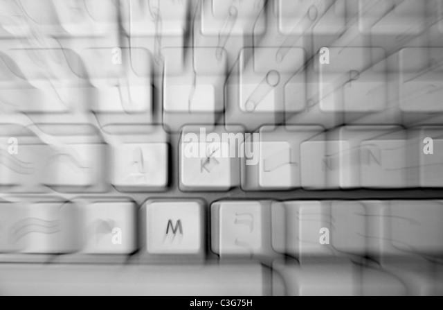 crazy keyborad zoom blurred keys as a disease metaphor - Stock Image