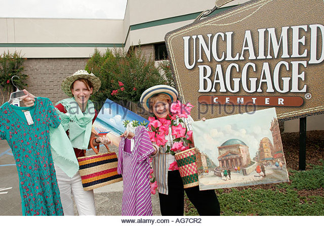 Alabama Scottsboro Unclaimed Baggage Center lost airline luggage cargo for sale shopping women - Stock Image