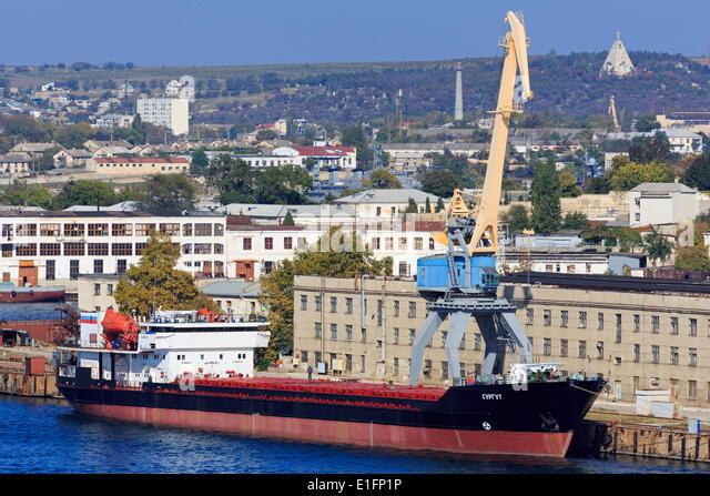 Cargo ship in South Harbour, Sevastopol, Crimea, Ukraine, Europe - Stock Image