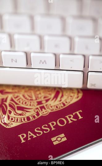 Passport with a computer keyboard - Stock-Bilder