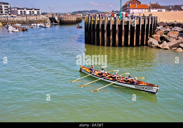 West Bay, Bridport, Dorset. 6th July, 2013.   Cornish Pilot Gigs take part in the Bridport Gig Regatta. Nine clubs - Stock Image