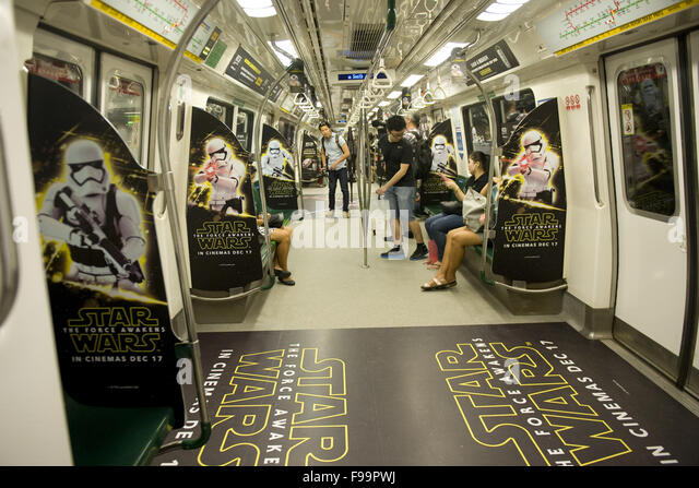Singapore. 15th Dec, 2015. Commuters take the subway of Singapore's Mass Rapid Transit decorated with promotional - Stock Image