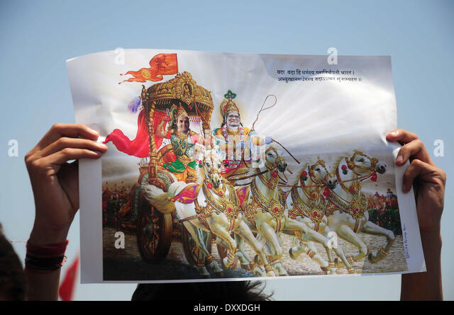 ALLAHABAD, INDIA - APRIL 1: Congress worker hold a poster in which Manmohan singh is shown as Lord Krishna and Rahul - Stock Image