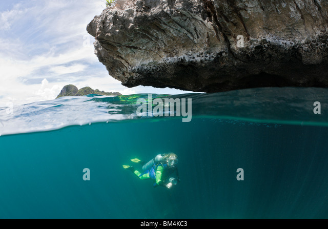 Scuba Diver in Shallow, Raja Ampat, West Papua, Indonesia - Stock Image