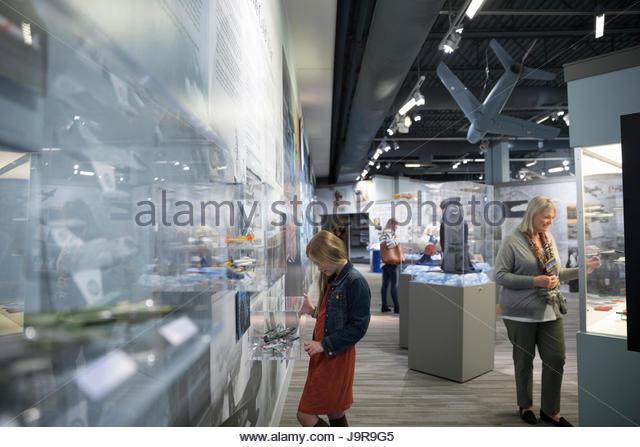 People looking at exhibits in war museum - Stock-Bilder