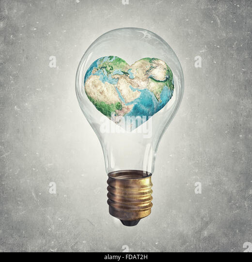 Glass light bulb and Earth planet inside. Elements of this image are furnished by NASA - Stock Image
