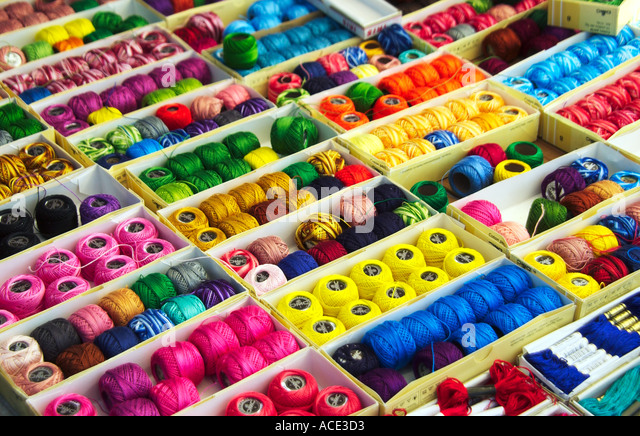 Colorful cloth thread and textiles in the Comolapa markets of Guatemala, Central America - Stock Image