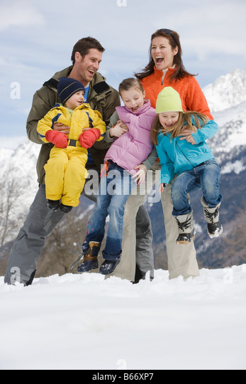 Family having fun in the snow - Stock Image